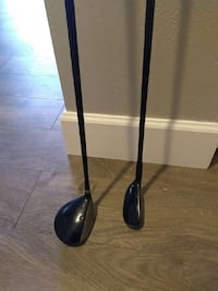 two black golf clubs