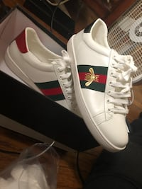 pair of white-and-red Adidas sneakers University City, 63132