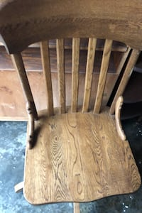 Chair solid oak and desk chair on rollers.  Great deal.