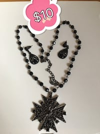 Silver and black necklace with cross pendant and pair of earrings!!! Vaughan