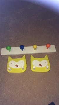 White blue yellow and red wooden wall rack