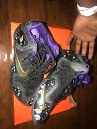 pair of black-and-purple Nike basketball shoes Pembroke Pines, 33025