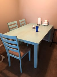 wooden table with three chairs dining set Carencro, 70507