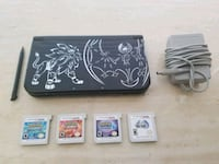 black Nintendo DS with game cartridges Oregon City, 97045