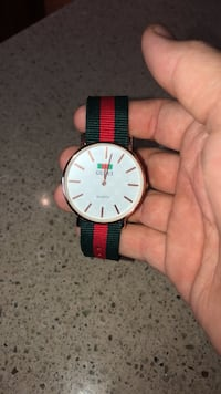Gucci watch very low price this time only  2055 mi