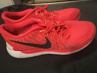 pair of red Nike running shoes Surrey, V3S
