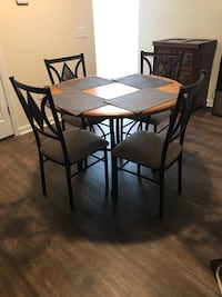 Round table with 4 chairs. Barely used