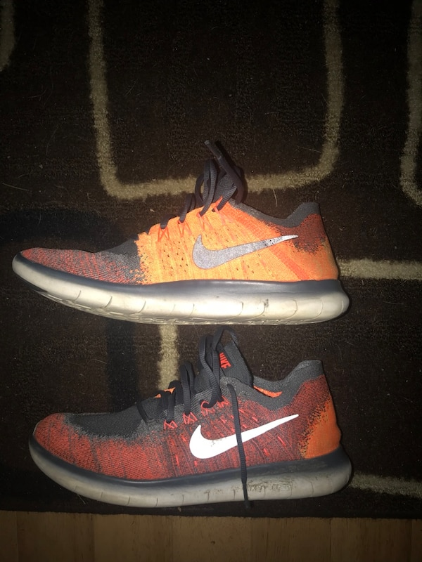 Pair of red-and-black nike sneakers