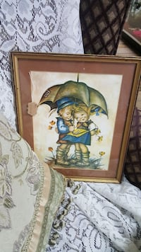 boy and girl standing under brown umbrella painting