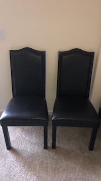 two black leather padded chairs 2388 mi