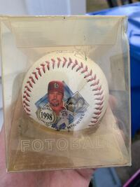 Mark McGwire autographed baseball with stats