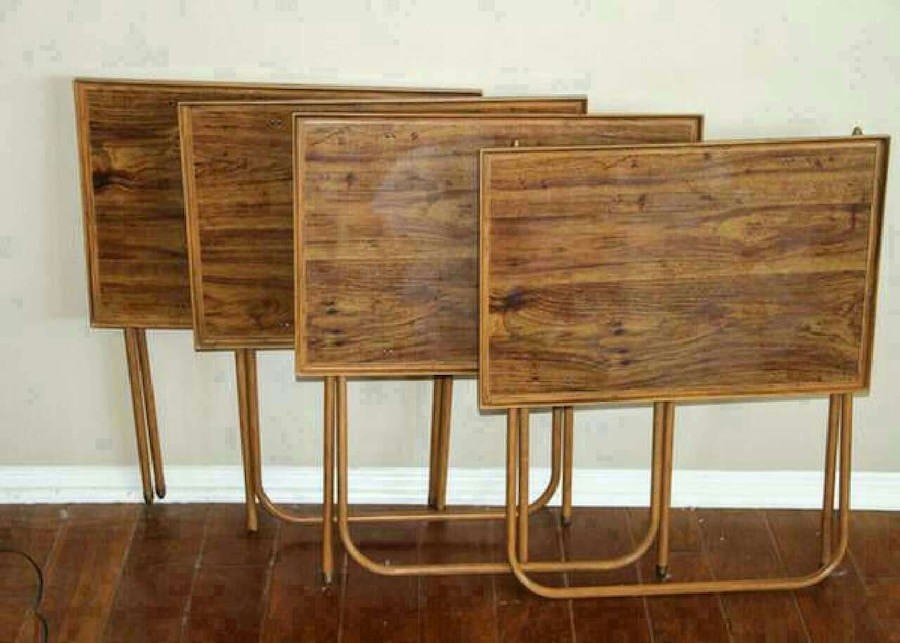 four brown folding tables
