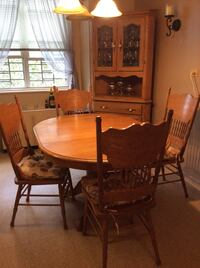 Oblong brown wooden table and four chairs set New York, 11239