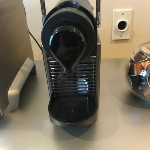 Nespresso coffee maker with lots of pods
