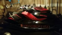 red and black personal watercraft