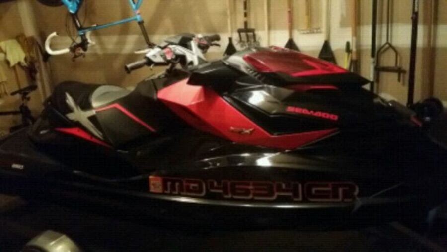 red and black personal watercraft 1a849035-9baa-4144-a14d-bc1de51eec28