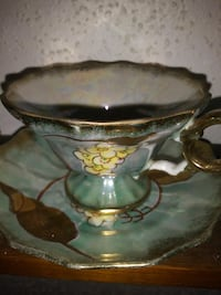 footed teal and white ceramic teapot on saucer Detroit, 48208