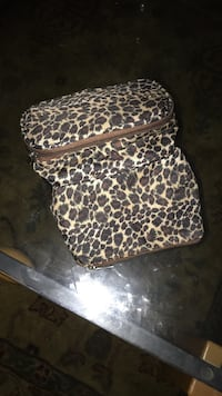 white and brown animal print pouch