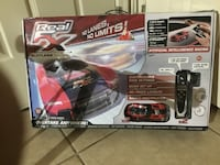 two black and red and gray Shark handheld vacuum cleaner