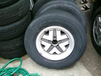gray 5-spoke car wheel with tire set Des Moines, 50317