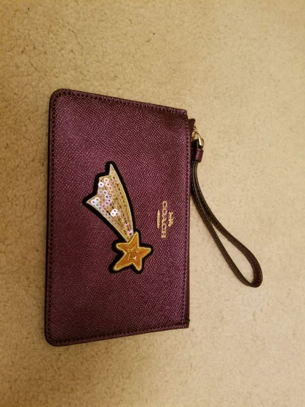 NWT COACH Purple ( Metallic Raspberry)Wristlet  c4ee59f3-776d-4bee-a72a-3857a0e40884