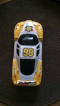 gray and yellow car scale model