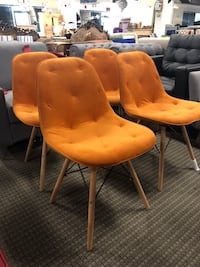 Set of 4 orange velvet dining chairs  24 mi