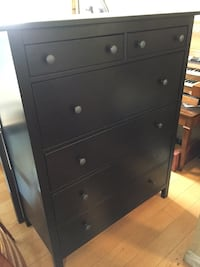 black wooden 5-drawer tallboy dresser