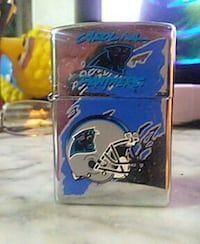 silver and gray football helmet flip lighter