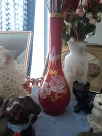 two white and red ceramic vases Fredericton