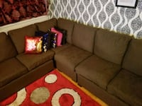 brown fabric sectional sofa with throw pillows 550 km