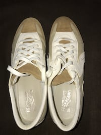 pair of brown-and-white Salvatore Ferragamo shoes