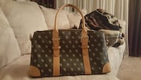 black and brown Dooney & Bourke monogrammed leather tote bag