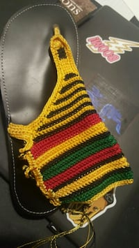 red, yellow, and black knitted scarf