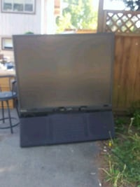 black flat screen TV with black wooden TV stand Surrey, V3R 7C1