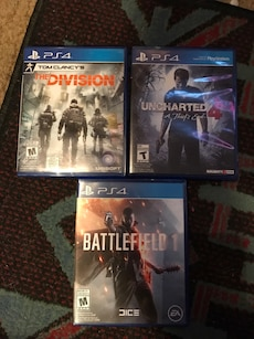 Three PS4 game cases