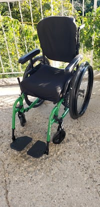 Monster green wheel chair  Kelowna, V1X 7L3