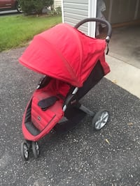 Baby's red and black jogging stroller