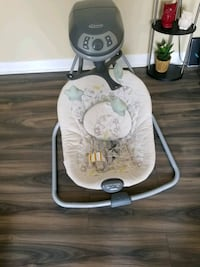 baby's white and gray Graco cradle and swing Toronto