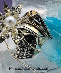 Silver and gold coloured M.Bison Street Fighter skull ring size: 8 Brampton, L6R 1X5