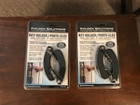 two black and gray wireless headphones boxes Calgary, T2P 2A8