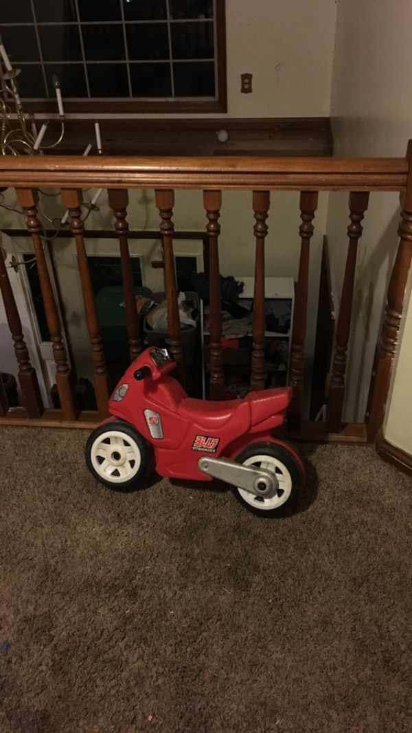 toddler's red and white bicycle ride-on toy