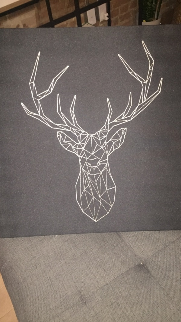 white and black deer artwork