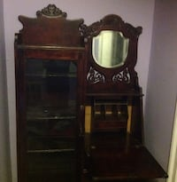 brown wooden cabinet with mirror New York, 10306