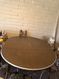 round brown wooden table with four chairs dining set Tucson, 85746