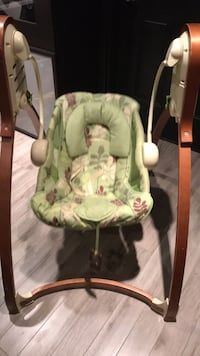 Baby's green wood frame swing chair
