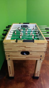brown, green, and white foosball table