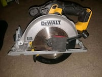 gray and yellow DEWALT circular saw