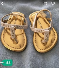Pair of gold-colored and white t-strap sandals screenshot Hyattsville, 20782