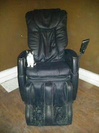 black leather padded rolling armchair Winnipeg, R3H 0J4